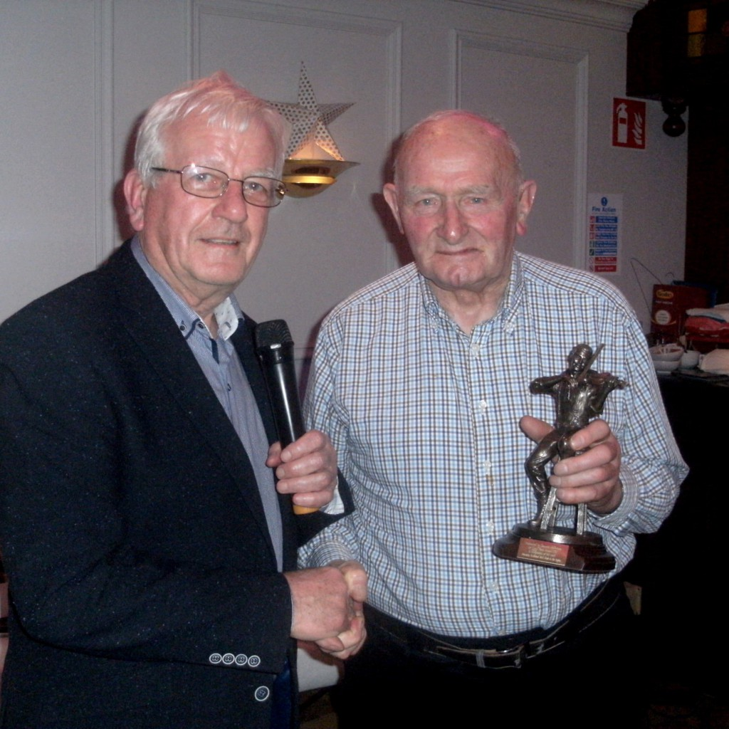Seamus McGovern being presented with his Gradam Breifne by Paddy McDermott